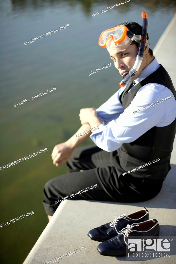 Stock Photo: Business man in mask & snorkel by river.