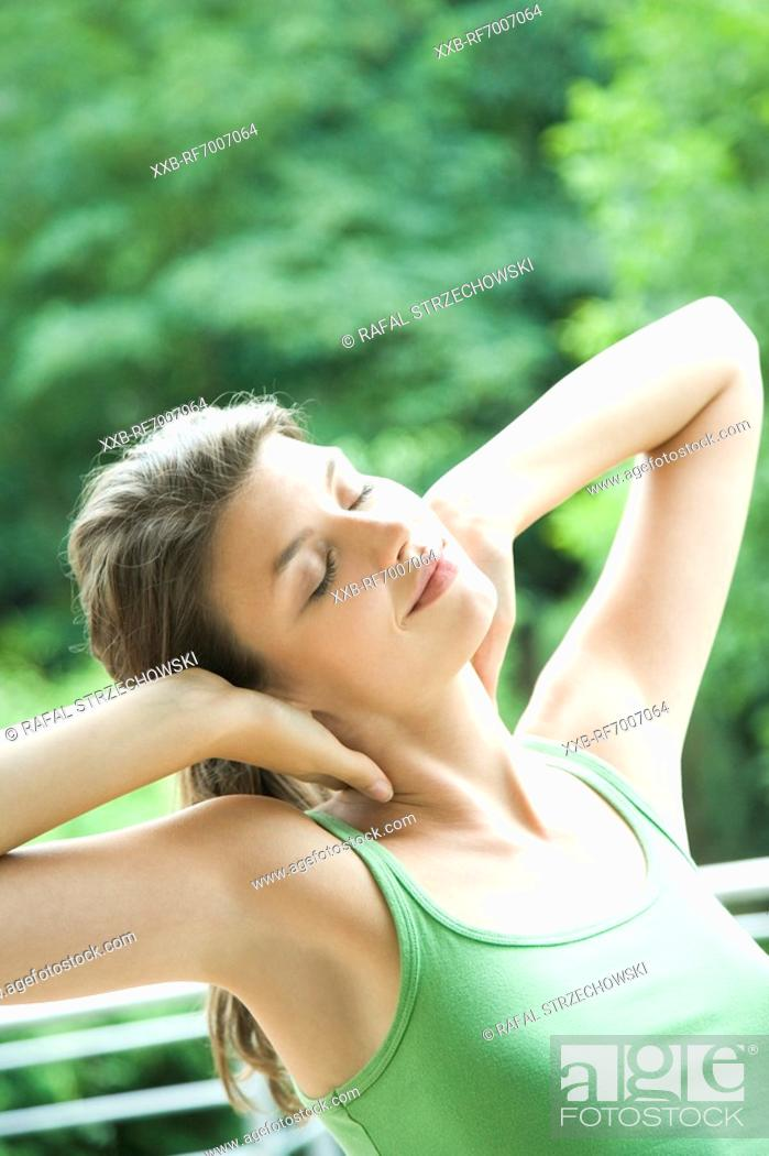 Stock Photo: Relaxing woman on the terrace.