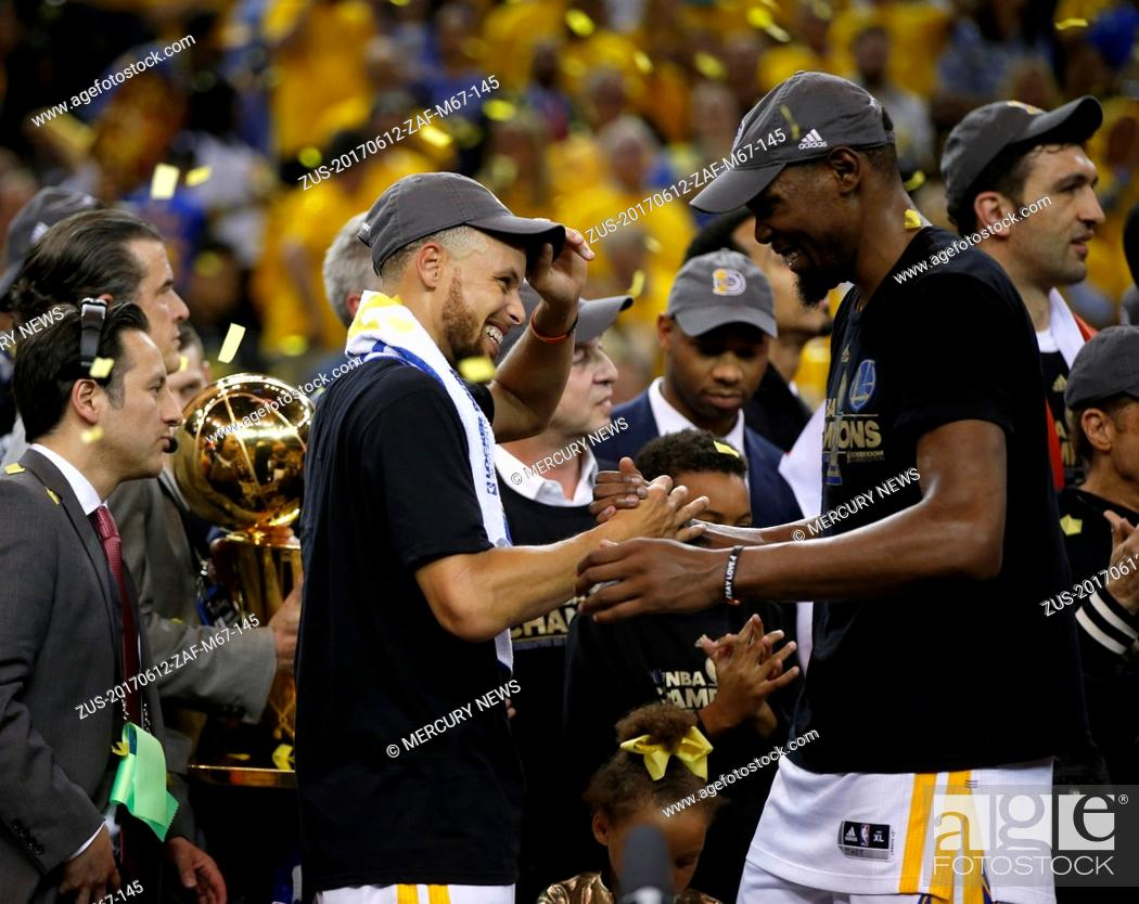 Stock Photo: June 12, 2017 - Oakland, CA, USA - The Golden State Warriors' Stephen Curry and Kevin Durant, right, celebrate after defeating the Cleveland Cavaliers, 129-120.