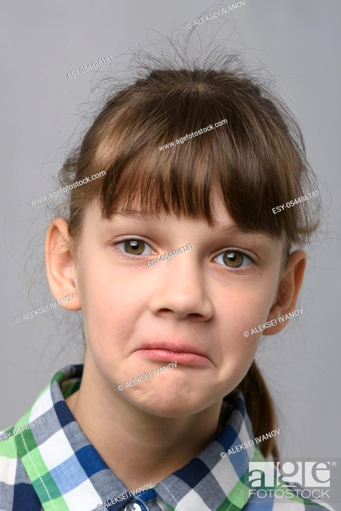 Stock Photo: Portrait of a surprised ten year old girl, European appearance, close-up.