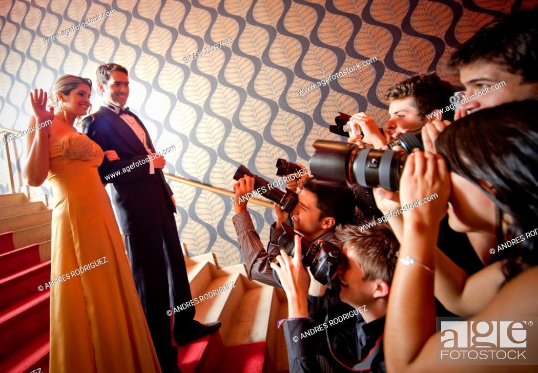 Stock Photo: Famous Hispanic couple posing for press photographers.