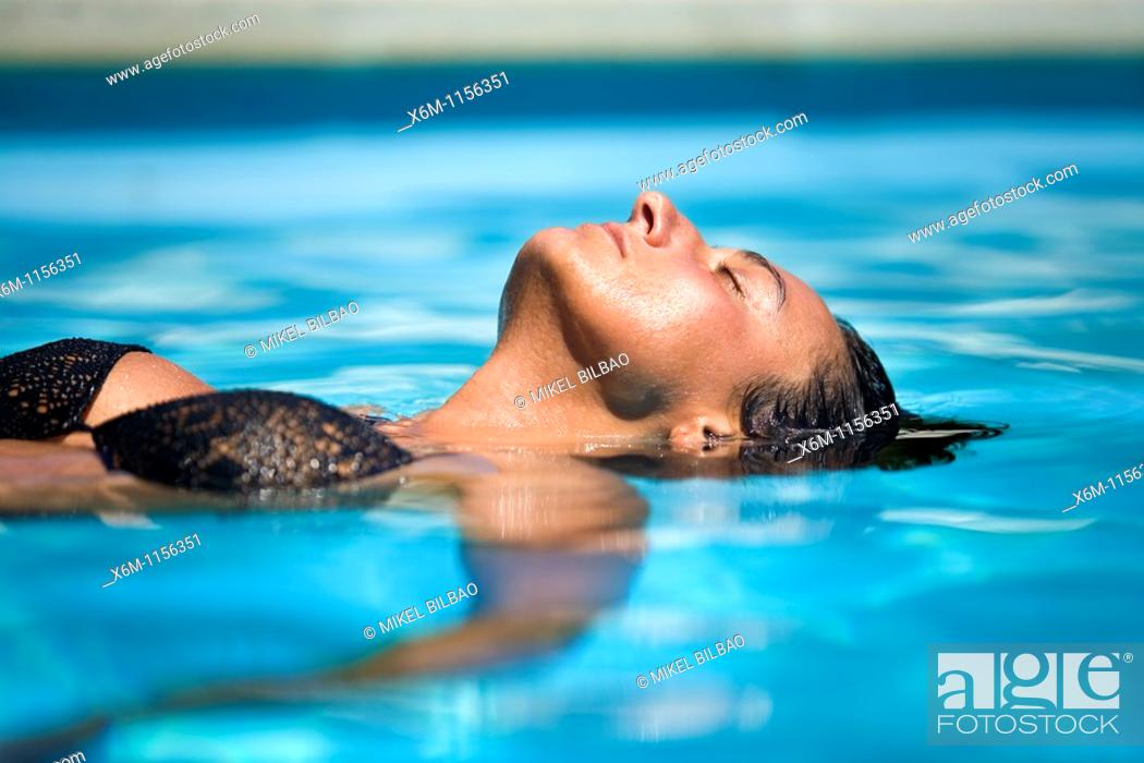 Stock Photo: young woman portrait in a swimming pool.