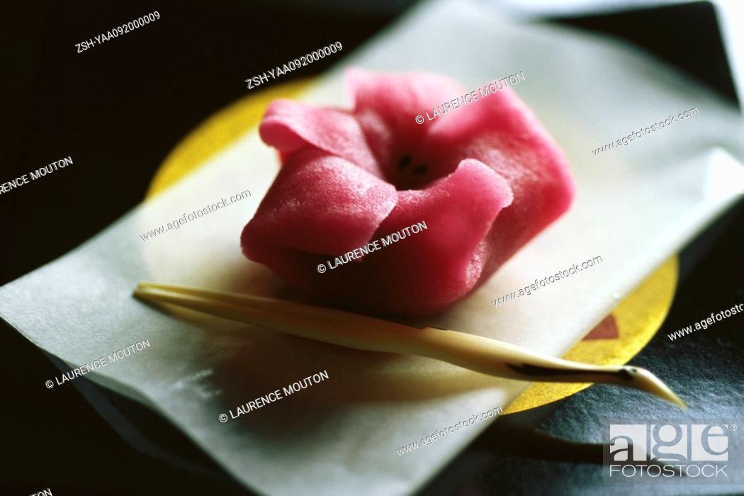 Stock Photo: Single pink wagashi on plate.