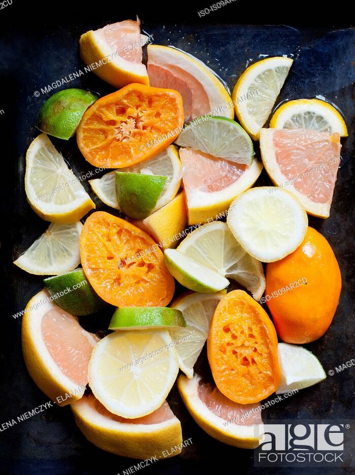 Stock Photo: Stack of squeezed oranges, with sliced grapefruit lime and lemons.