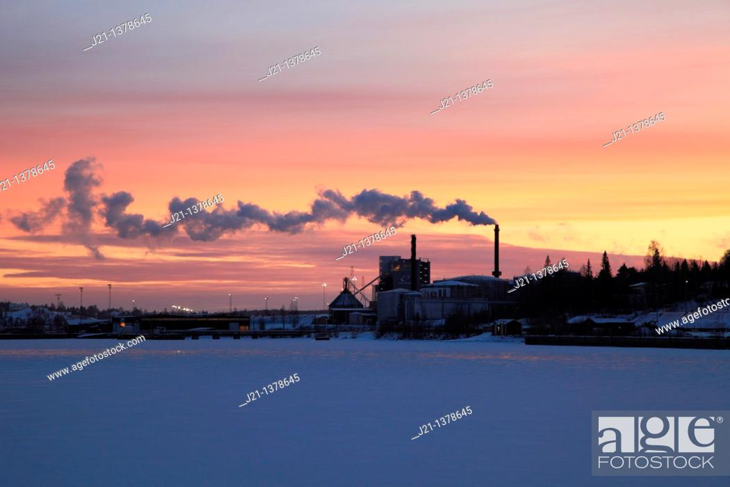 Stock Photo: Power plant at sunset, situated on the banks of a frozen bay of the Baltic Sea in Sweden.