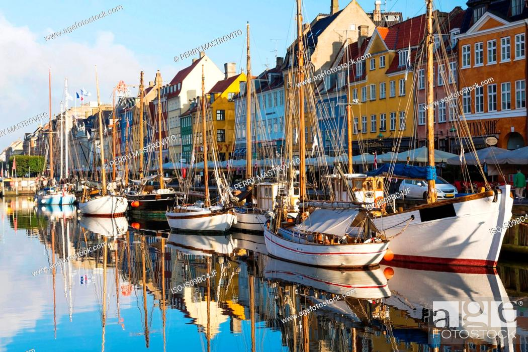 Stock Photo: Moored boats and colourful 17th century town houses on Nyhavn canal, Copenhagen, Denmark.