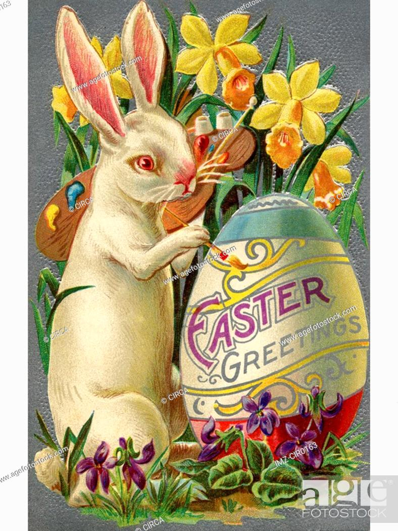 Stock Photo: A vintage Easter postcard of a rabbit painting an egg.