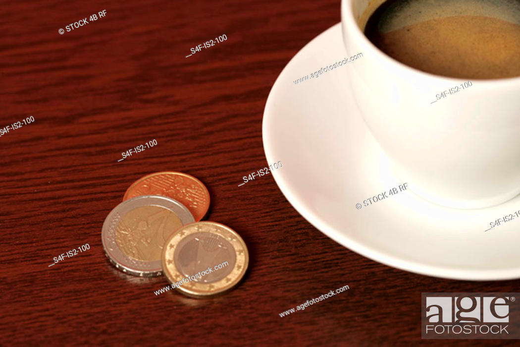 Stock Photo: Coffee cup and tip on a wooden underlay (part of), close-up.