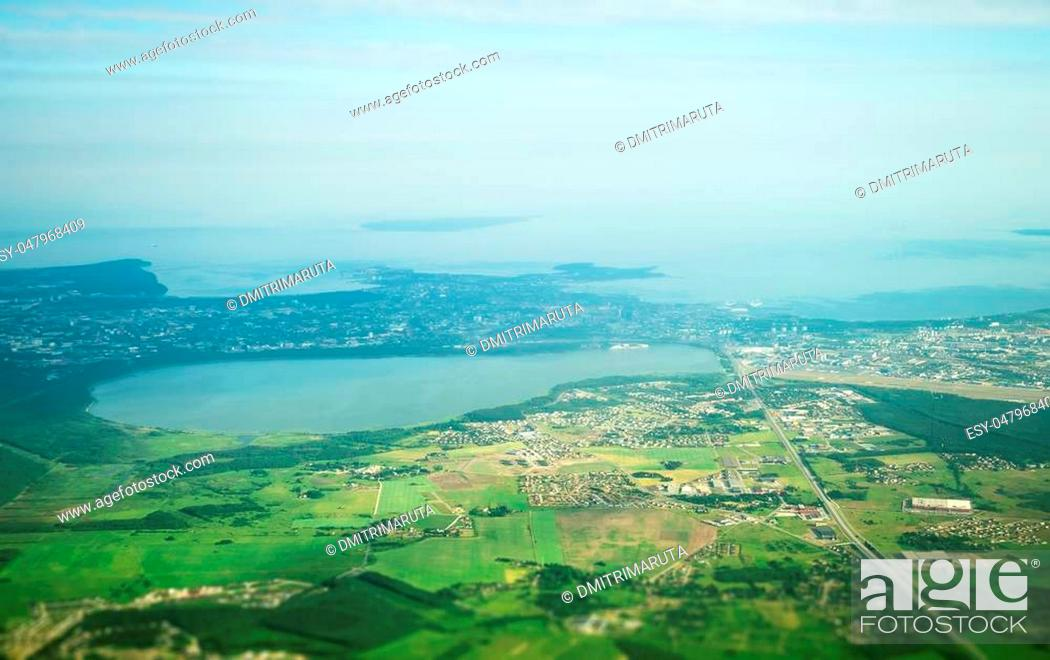 Stock Photo: View from the plane to lake Ulemiste, Airport and Peetri village.