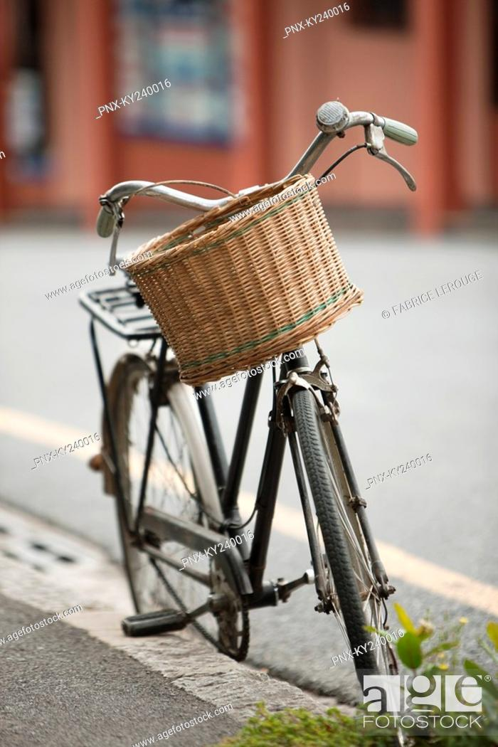 Stock Photo: Bicycle parked at the roadside.