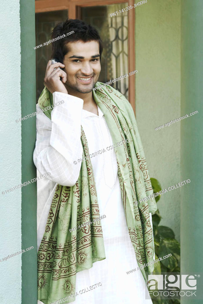Stock Photo: Portrait of a young man talking on a mobile phone.