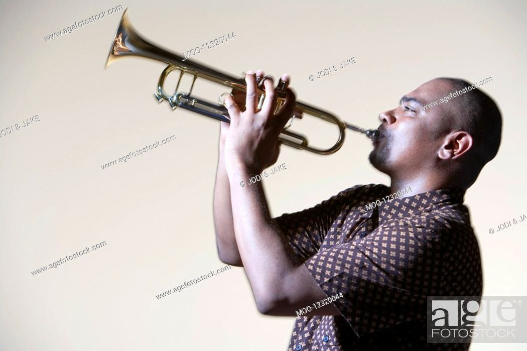 Stock Photo: Man Playing Trumpet close-up side view.
