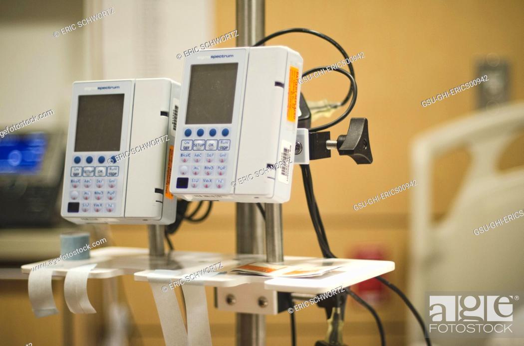 Digital Hospital Infusion Pumps on IV Pole, Stock Photo