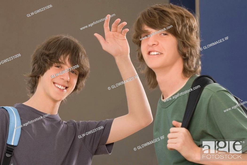 Stock Photo: Portrait of two teenage boys smiling.