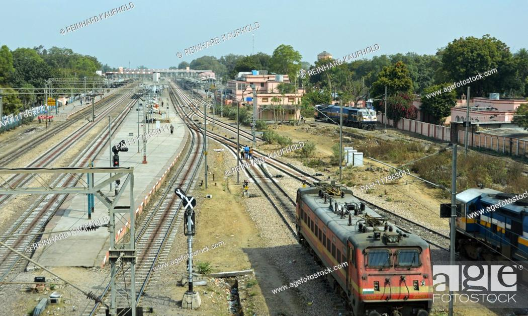 Stock Photo: Railroad track at a railway station in North India (Rajasthan state) - in the foreground a locomotive of the Indian Railways, taken on 31.01.
