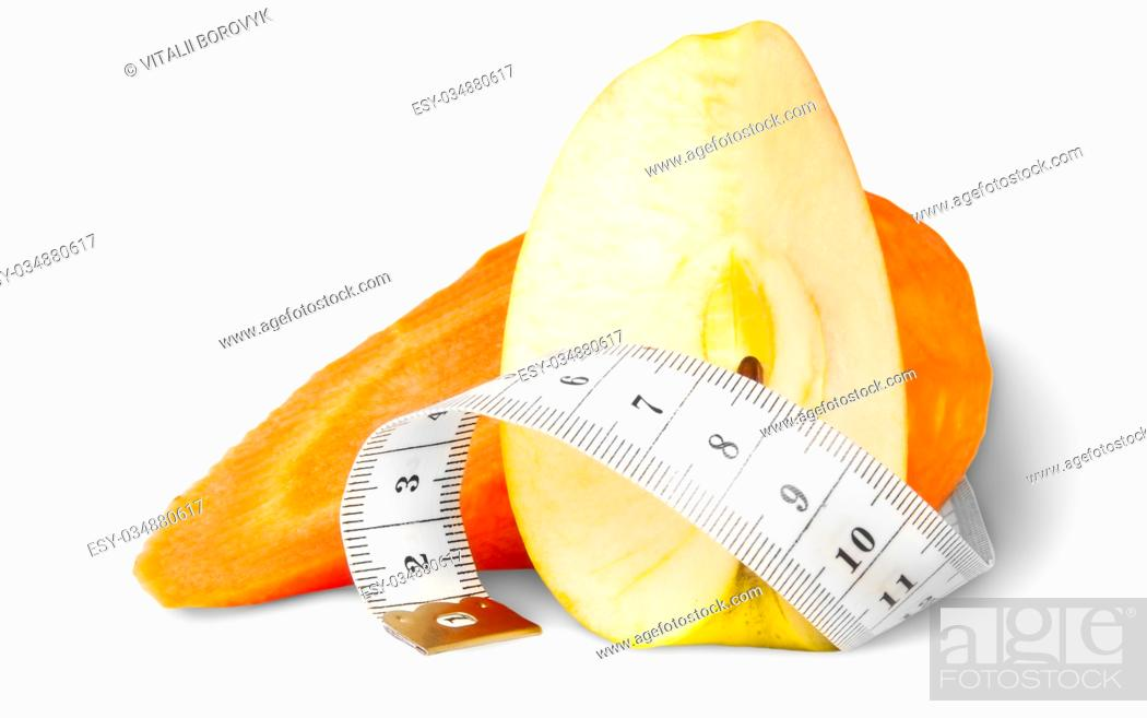 Stock Photo: Slices Carrot With Apple And Sewing Measuring Isolated On White Background.