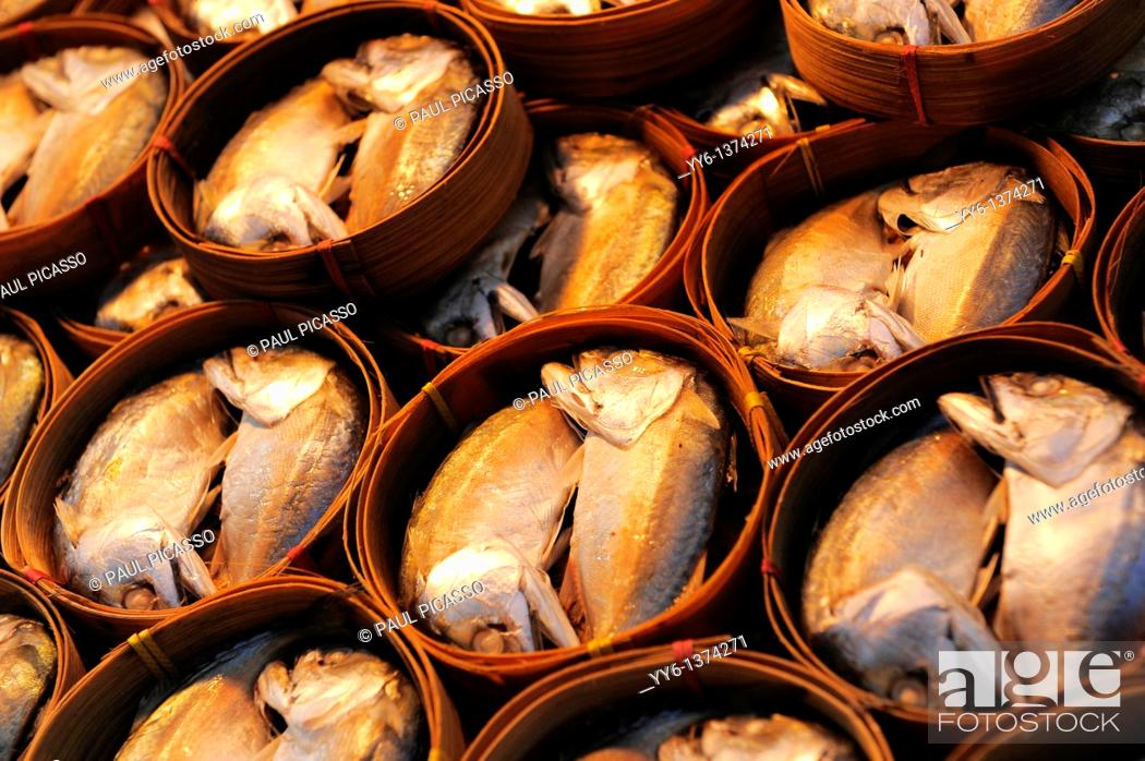 Stock Photo: two head fish on display , also known as Pla thu a kind of mackerel is often eaten together with nam phrik kapi , klong toey klong toei market , bangkok.