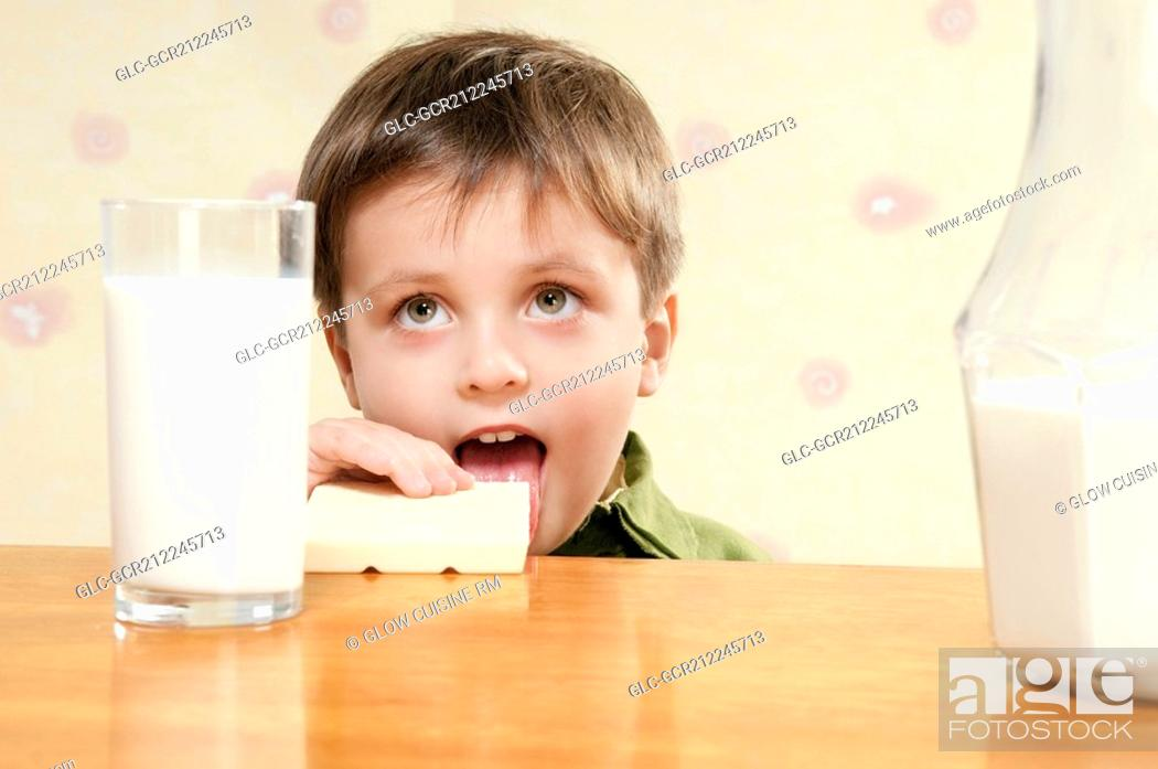 Stock Photo: Close-up of a boy eating breakfast.