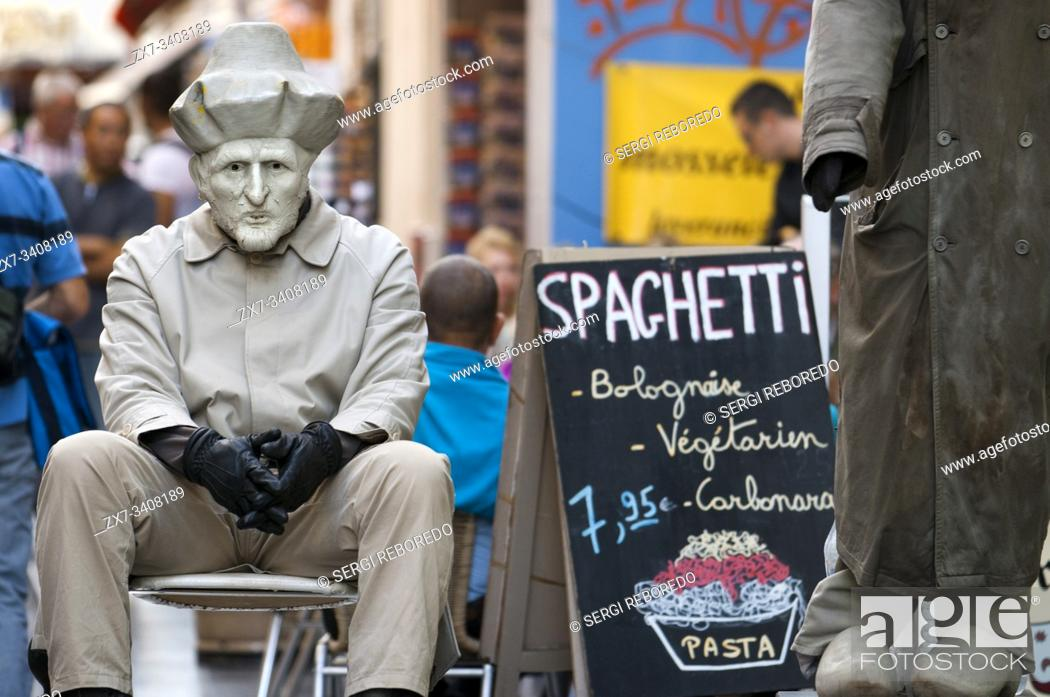 Stock Photo: Advertising man of spaghetti pasta at Rue du Marche aux Fromages, Brussels, Belgium. Several restaurants at Rue du Marche aux Fromages, Brussels, Belgium.