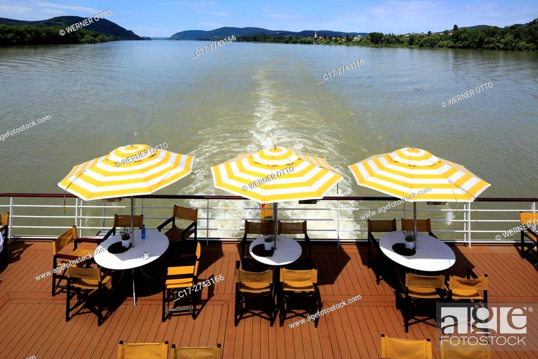 Imagen: tourism, holiday, freetime, Danube river cruise, Danube navigation, open afterdeck on an aROSA cruiser, restaurant, dishes, chairs, sunshades.