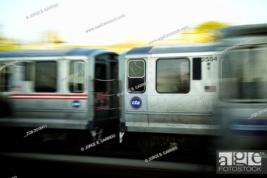 Stock Photo: Train moving on the tracks at CTA Station in Chicago.