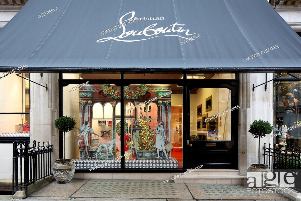 1e8238045664 Stock Photo - View of the store. Christian Louboutin - Christmas Windows