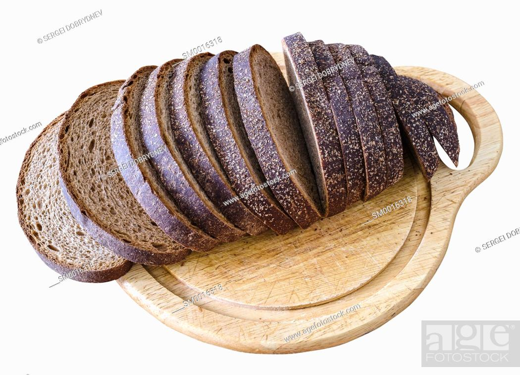Stock Photo: Sliced loaf of rye bread on a cutting board isolated on white.