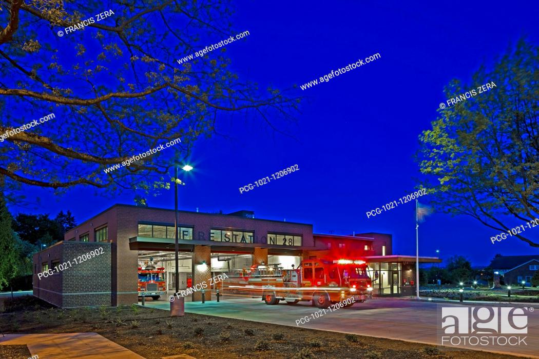 Stock Photo: Fire Engine Leaving a Station at Night.