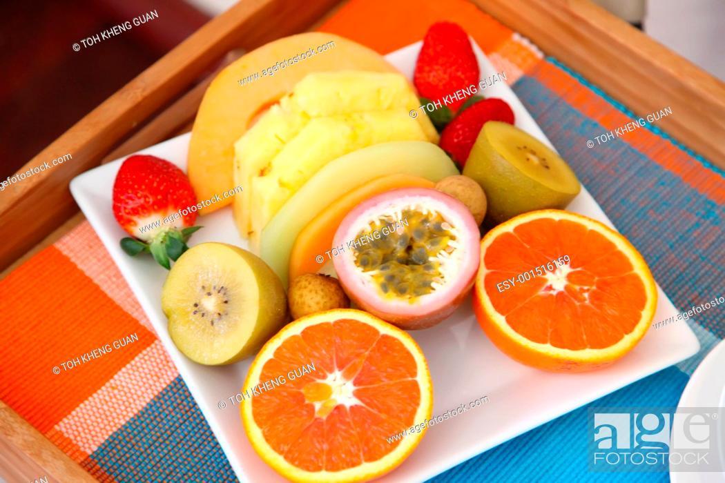Stock Photo: Tropical fruits tray breakfast.