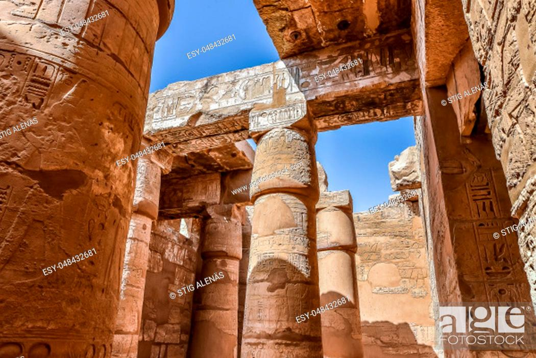 Stock Photo: Columns and blue sky in the great hypostyle hall at the temple of Amon-Re in Karnak, Egypt, October 22, 2018.
