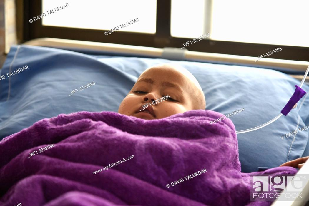 Stock Photo: World Cancer Day. Guwahati, Assam, India. 4 February 2019. A Child Cancer patient on a bed at Dr. Bhubaneswar Borooah Cancer Institute and research centre in.