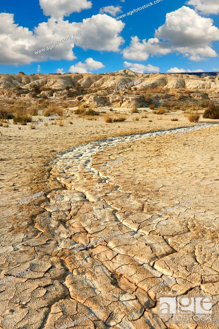 Stock Photo: Rock formations and dried cracked mud in the Bardena Blanca area of the Bardenas Riales Natural Park, Navarre, Spain.