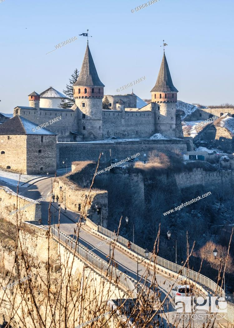 Stock Photo: Kamianets-Podilskyi, Ukraine. Panoramic view of the Kamianets-Podilskyi fortress on a sunny winter morning.