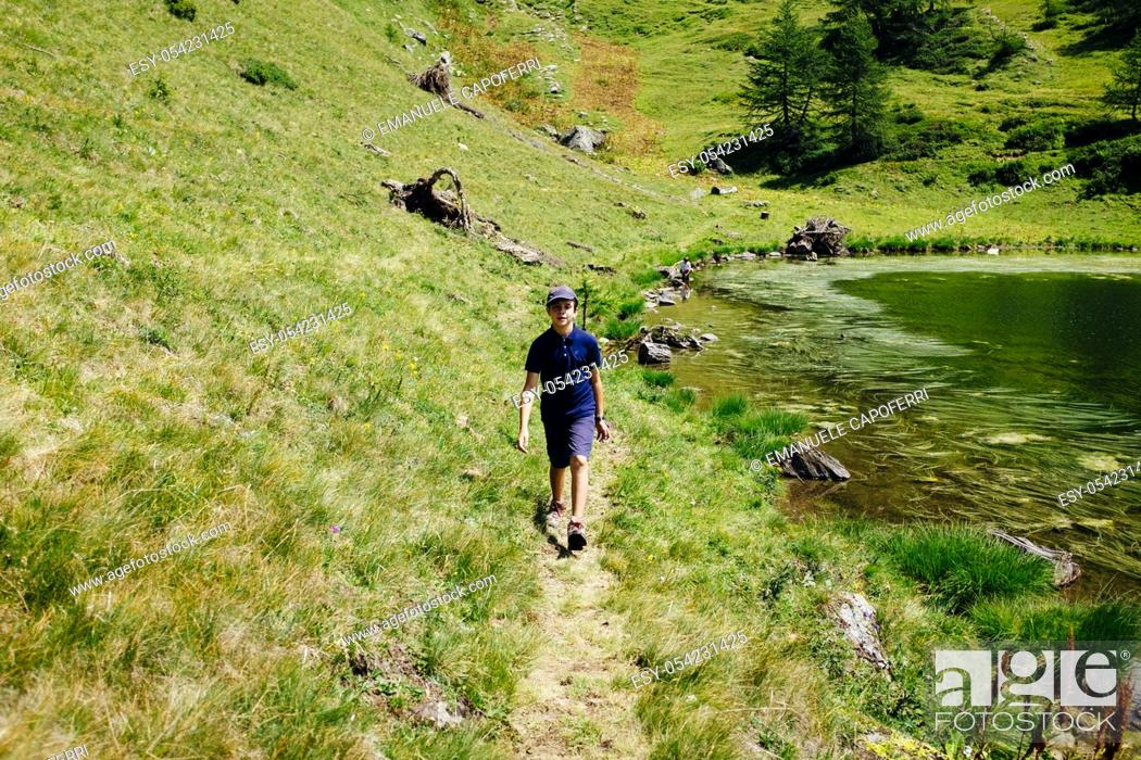 Stock Photo: little boy walking on mountain path. Alpe Devero, Piemonte, Italy.