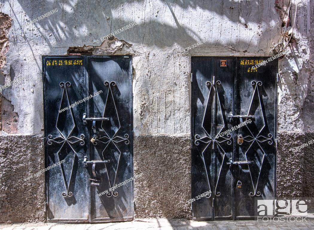 Stock Photo: Two heavy metal doors with decorative design on them in medina quarter of Marrekech, Morocco.