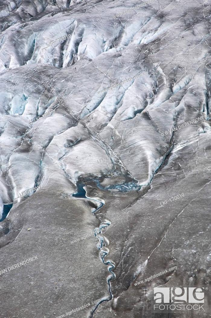 Stock Photo: A small creek and structures on the Aletsch Glacier, Canton of Valais, Switzerland.