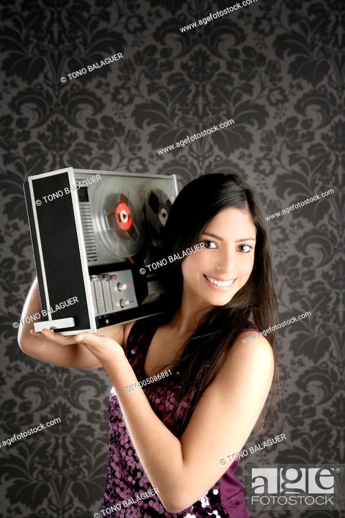 Stock Photo: Retro open reel tape recorder beautiful brunette Dj.