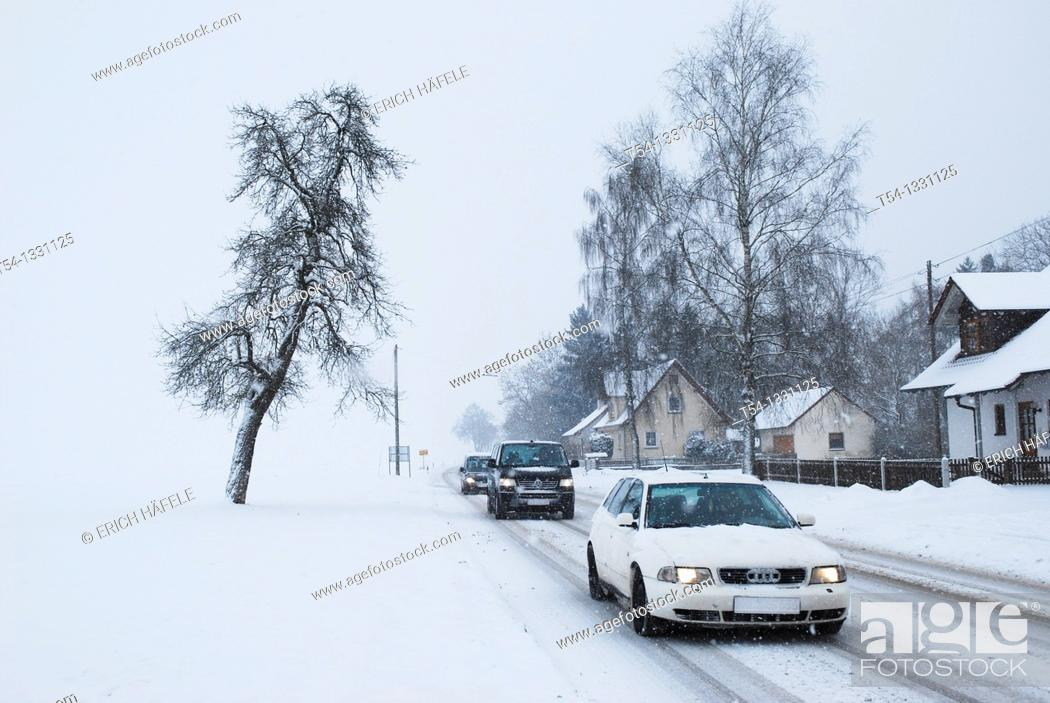 Stock Photo: Winter road conditions on a country road.
