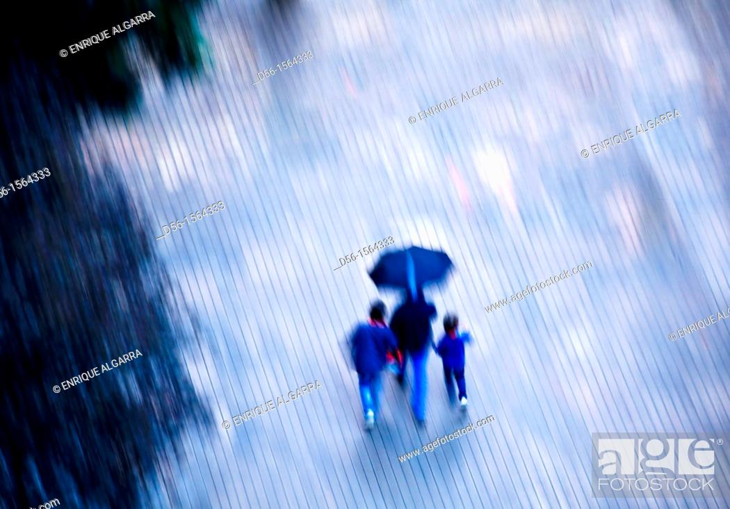 Stock Photo: Pedestrians in the rain, Valencia, Spain.