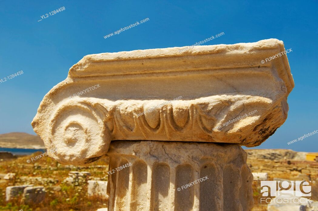 Stock Photo: Delphic coloumn capitals of the ruins of the Greek city of Delos, the birthplace of the twin gods Apollo and Artemis  Greek Cyclades Islands.