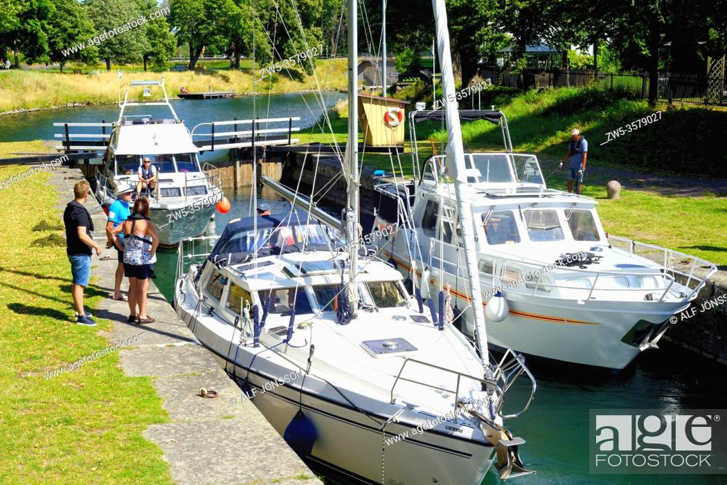 Stock Photo: Leisure boats in a lock in Gota Canal at Motala, Ostergotland, Sweden. The Gota Canal was constructed in the 19th century.