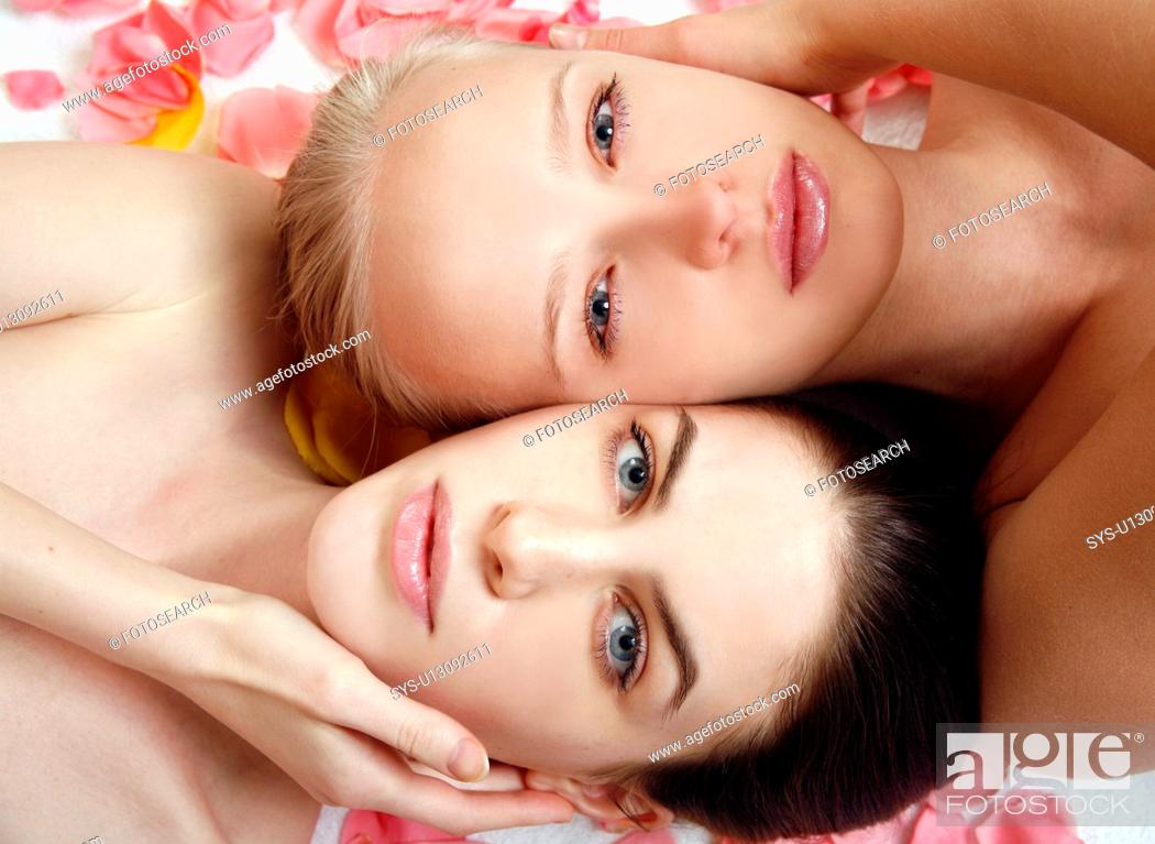 Stock Photo: Beauty shot of two young faces side by side.