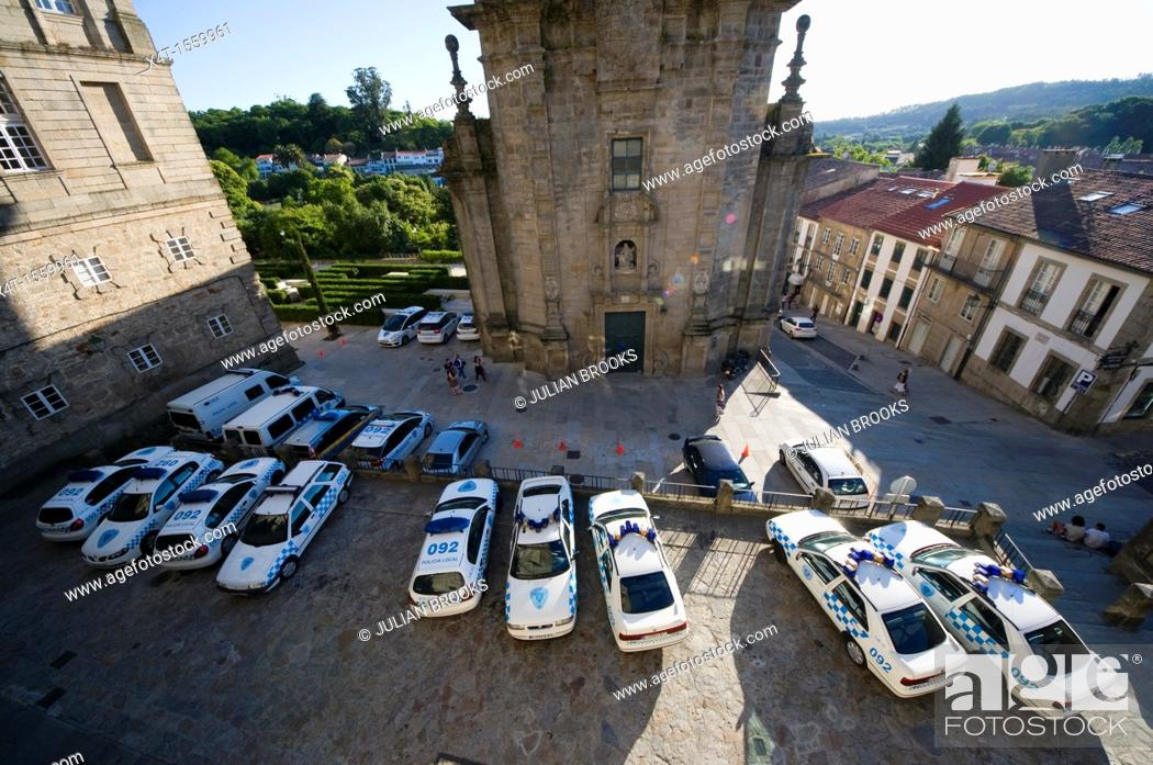 Stock Photo: Police cars parked in Santiago De Compostela during a political protest in the Cathedral square.