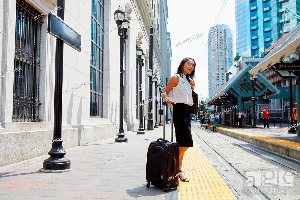 Stock Photo: Businesswoman waiting on light rail platform.
