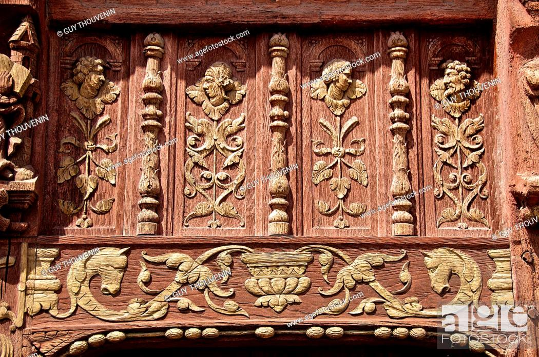 Stock Photo: Faces and floral motif carved in wood on norman Henry IV house facade, Renaissance time, Saint Valery en Caux, Normandy, France.