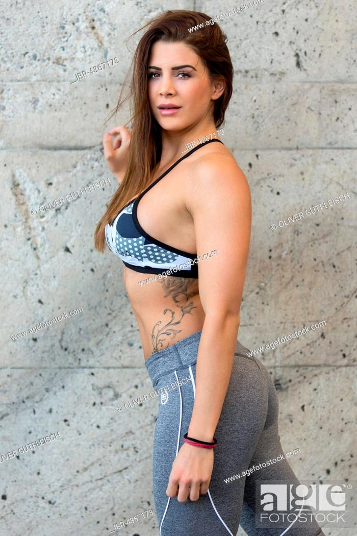 Stock Photo: Portrait of a young woman in sporty outfit, fashion, lifestyle.