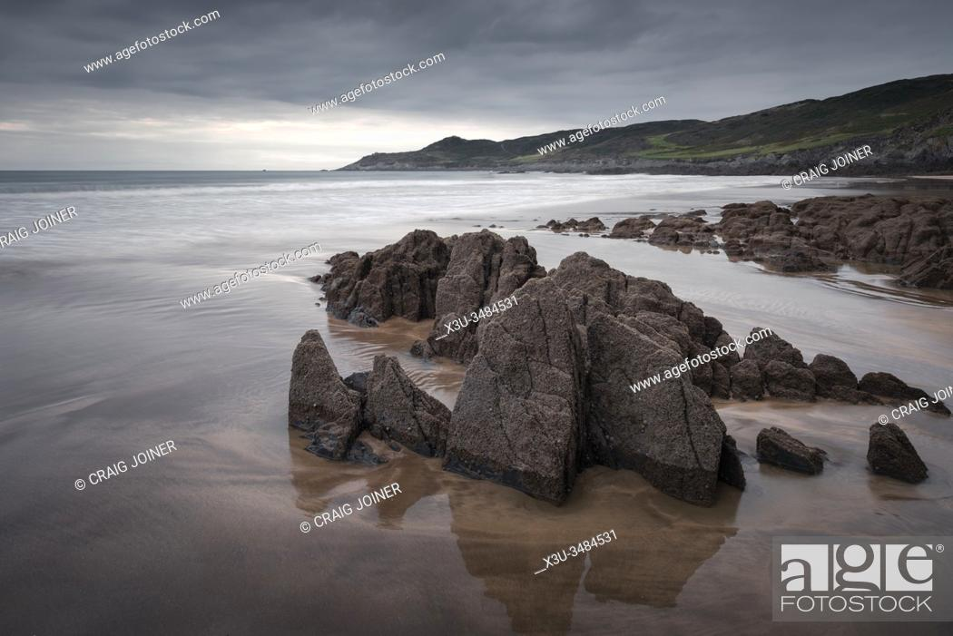 Stock Photo: Combesgate Beach and Morte Point on the North Devon coast at Woolacombe, England.