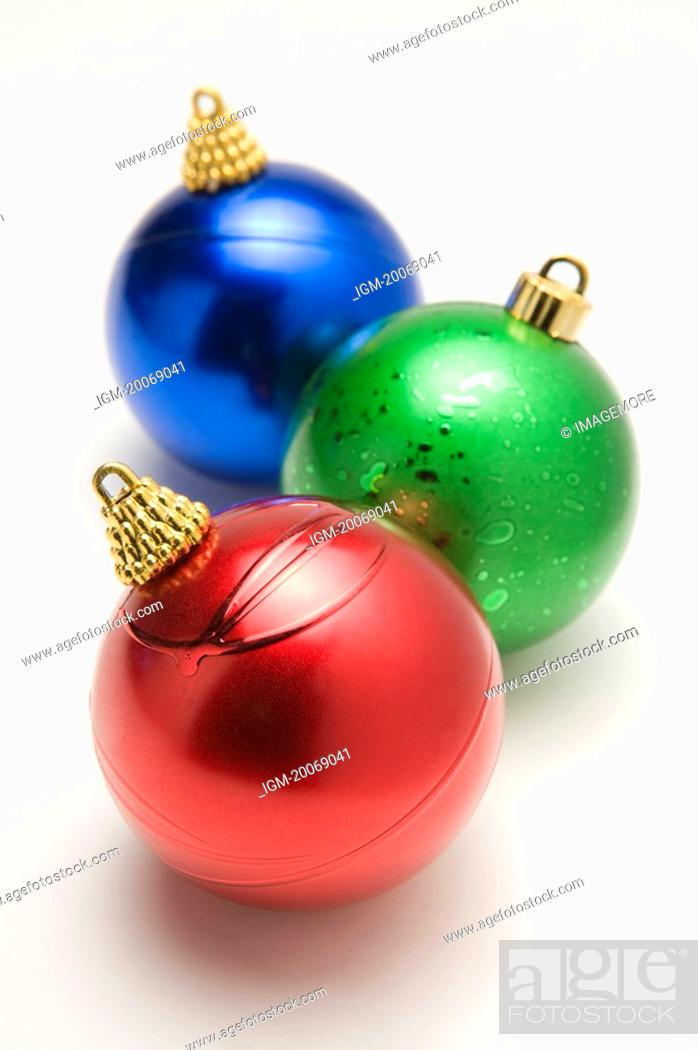 Stock Photo: Three Christmas baubles.