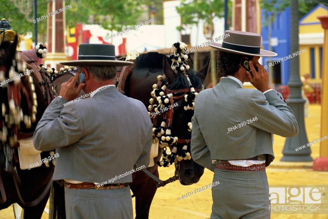Stock Photo: Men in traditional dress using mobile phones, Feria del Caballo Horse Fair, Jerez de la Frontera, Cadiz area, Andalucia Andalusia, Spain, Europe.