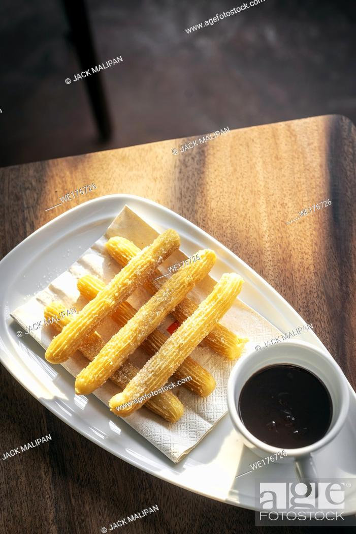 Stock Photo: churros con chocolate traditional spanish sweet breakfast set on wooden table.